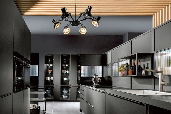 Image of a modern and streamlined kitchen design featuring bold and contrasting colours and materials