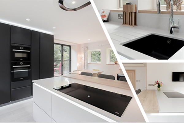 Image of a striking black and white modern handleless kitchen design, featuring clean and minimalistic styling elements.)