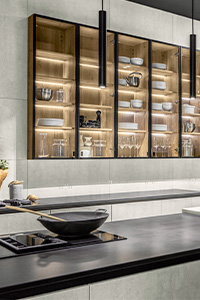 A close-up image of transparent wooden hanging cabinets in a nature-inspired kitchen