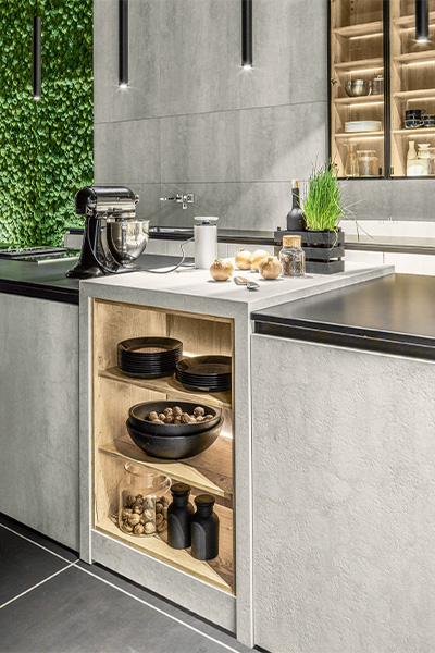 A close-up portrait image of the storage solutions in this nature-inspired kitchen
