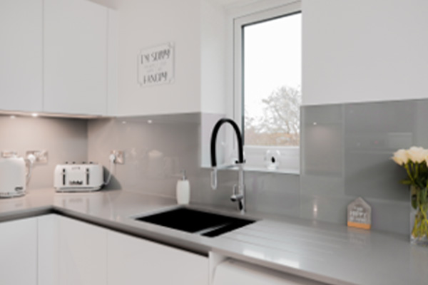 Image the Pronorm X-Line range featuring a contrasting kitchen sink with the white kitchen design.