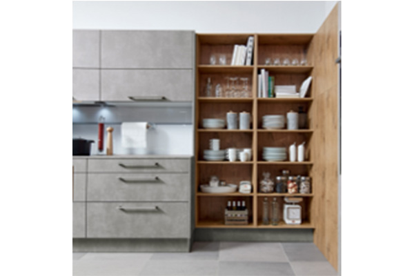 Image of a wooden floor to ceiling cabinet storing a variety of items