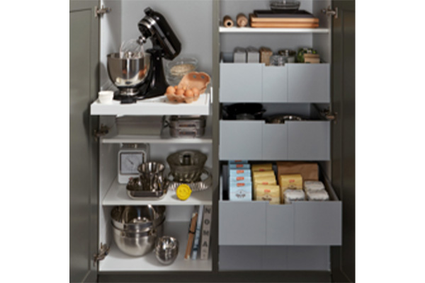 Close up image of the storage solutions within a grey kitchen cabinet