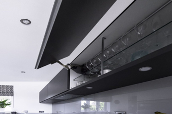 Image of a black overhead kitchen cabinet storing glasses and cups.