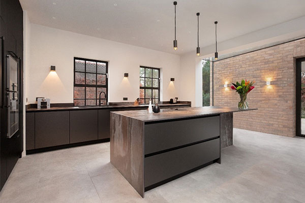 Image of Pronorm's Y-Line handleless kitchen range featuring Platinum Organic Glass and Alba Oak Black